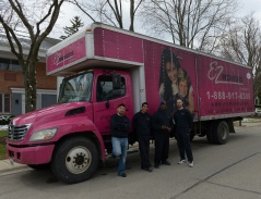 E-Z Movers' signature pink trucks